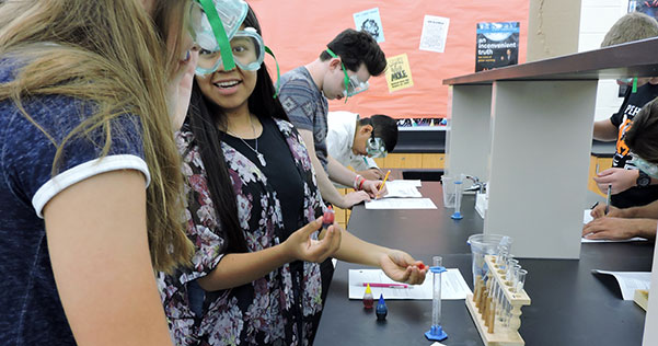 students participate in a science lab experiment